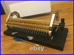 The Sally Stanley Smocking Pleater in original box + pleater feeder + books